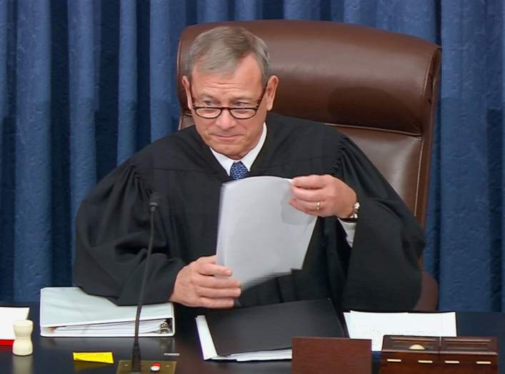 Chief Justice of the United States John Roberts presides during opening arguments in the U.S. Senate impeachment trial of U.S. President Donald Trump in this frame grab from video shot in the U.S. Senate Chamber at the U.S. Capitol in Washington, U.S.