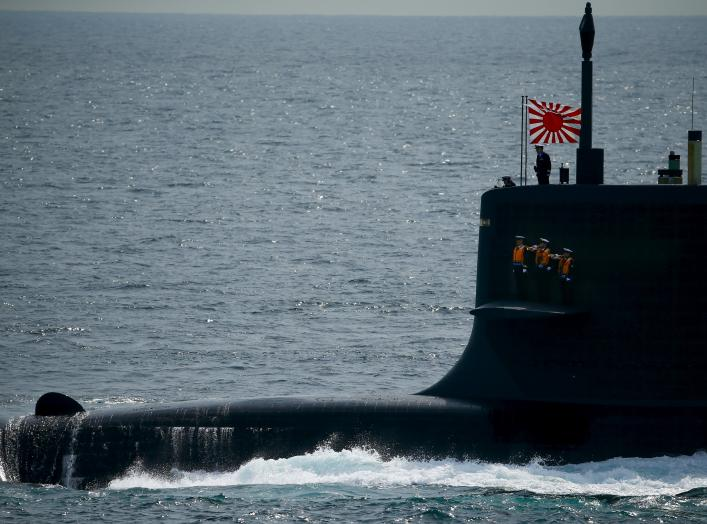 Sailors stand aboard the Kokuryu submarine of the Japanese Maritime Self-Defense Force (JMSDF) during its fleet review at Sagami Bay, off Yokosuka, south of Tokyo October 15, 2015. REUTERS/Thomas Peter