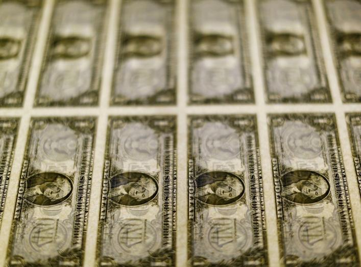 United States one dollar bills are seen on a light table at the Bureau of Engraving and Printing in Washington in this November 14, 2014, file photo. Dollar bulls were on the defensive on March 30, 2016 after Federal Reserve chair Janet Yellen's cautious