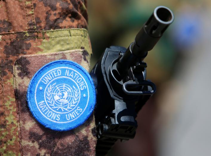 The weapon of a peacekeeper of the United Nations Interim Force in Lebanon (UNIFIL) is pictured during a handover ceremony from Italian Major-General Luciano Portolano to Irish Major-General Michael Bearyover the command of Lebanon's U.N. peacekeeping for
