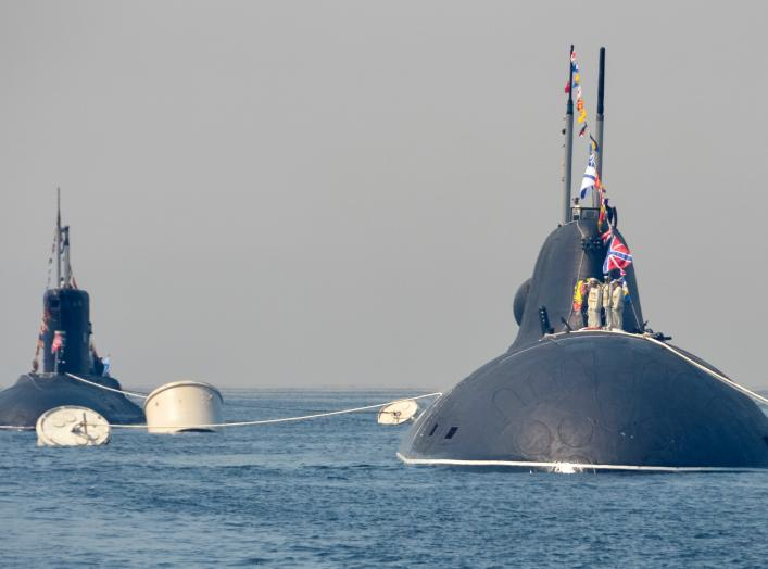 Russian submarines sail during a rehearsal for the Navy Day parade in the far eastern port of Vladivostok, Russia, July 30, 2016. REUTERS/Yuri Maltsev