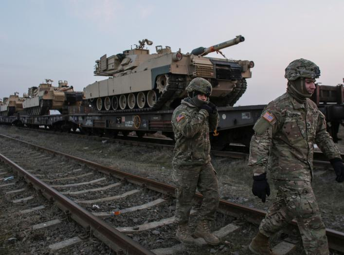 US soldiers walk next to M1 Abrams tanks at the Mihail Kogalniceanu Air Base, Romania, February 14, 2017. Inquam Photos/Octav Ganea/via