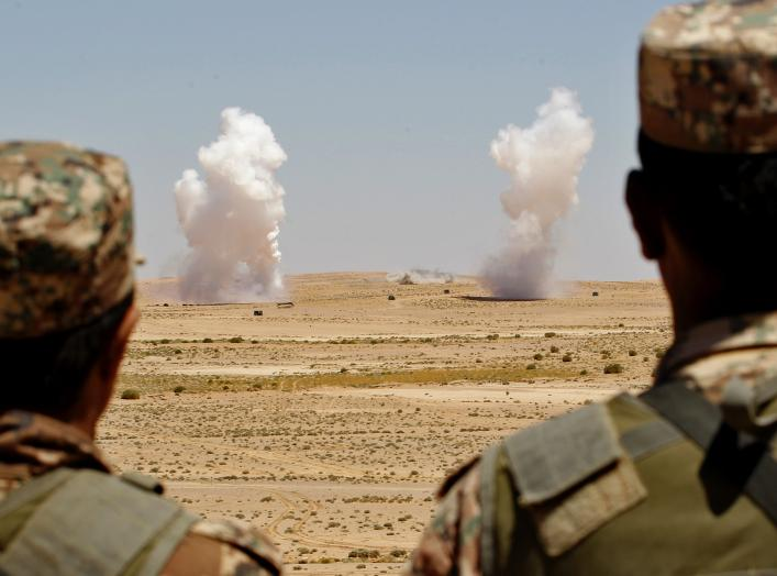 "Jordanian soldiers watch smoke rising during an artillery drill, part of the ""Eager Lion"" military exercise near the southern town of Al Quweira, 50 km (30 miles) from the coastal city of Aqaba, June 19, 2013. Eager Lion military exercise, set to take pla"