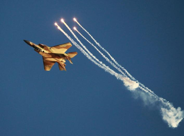 An Israeli air force F-15I fighter jet releases flares during an air force pilots' graduation ceremony at Hatzerim air base in southern Israel June 27, 2013. Some 30 cadets graduated on Thursday where they were addressed by Israel's Prime Minister Benjami