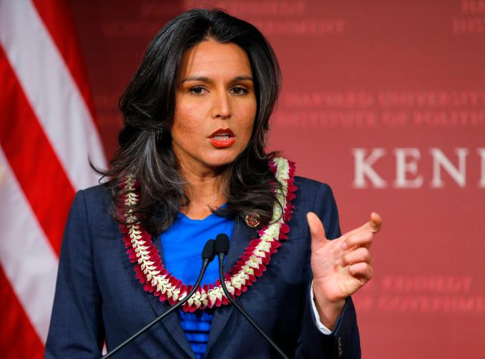 S. Representative Tulsi Gabbard (D-HI) speaks after being awarded a Frontier Award during a ceremony at the Kennedy School of Government at Harvard University in Cambridge, Massachusetts November 25, 2013. REUTERS/Brian Snyder