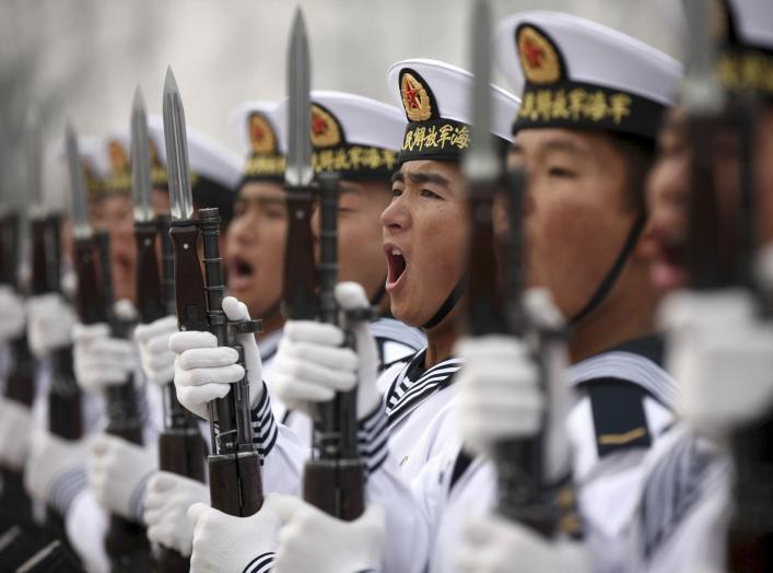 Chinese People's Liberation Army Navy recruits chant slogan during a parade to mark the end of a semester at a military base of the North Sea Fleet, in Qingdao, Shandong province December 5, 2013. REUTERS/China Daily