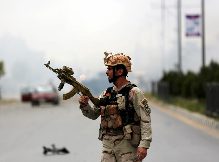 A member of Afghan security forces holds a rifle at the site of an attack near the Afghan parliament in Kabul, Afghanistan June 22, 2015. A Taliban suicide bomber and six gunmen attacked the Afghan parliament on Monday, wounding at least nineteen people a