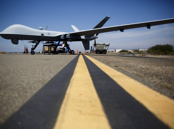 "A General Atomics MQ-9 Reaper stands on the runway during ""Black Dart"", a live-fly, live fire demonstration of 55 unmanned aerial vehicles, or drones, at Naval Base Ventura County Sea Range, Point Mugu, near Oxnard, California July 31, 2015. REUTERS/Patri"