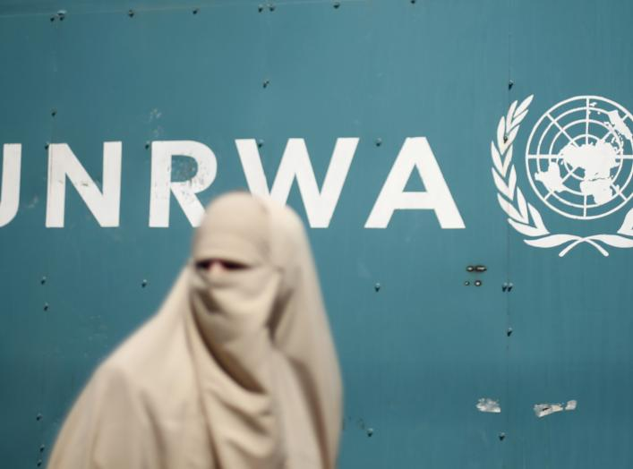 A Palestinian woman takes part in a protest against possible reductions of the services and aid offered by United Nations Relief and Works Agency (UNRWA), in front of UNRWA headquarters in Gaza City August 16, 2015. REUTERS/Mohammed Salem