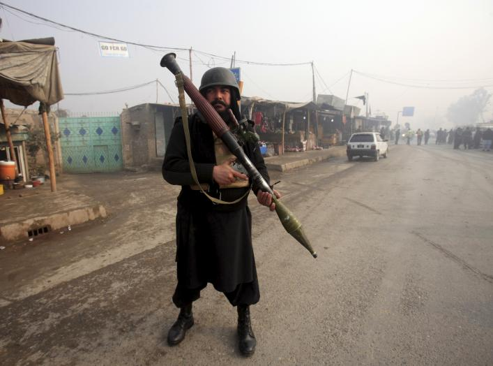 An armed paramilitary soldier stands guard after a suicide bomber blew himself up close to a police checkpoint in Peshawar, Pakistan January 19, 2016. REUTERS/Fayaz Aziz
