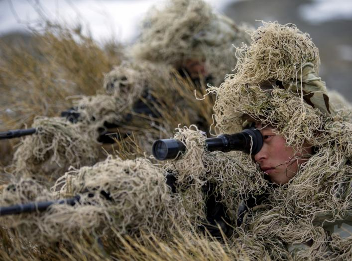Soldiers of the People's Liberation Army (PLA) Marine Corps are seen in training at a military training base in Bayingol, Xinjiang Uighur Autonomous Region, January 20, 2016. REUTERS/Stringer