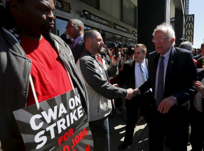 U.S. Democratic presidential candidate and U.S. Senator Bernie Sanders greets Communications Workers of America (CWA) workers striking against Verizon in Brooklyn, New York April 13, 2016. REUTERS/Brian Snyder