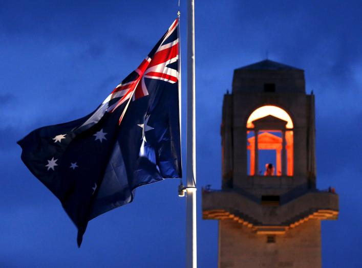 An Australian flag is flown at half mast during the dawn service to mark the ANZAC (Australian and New Zealand Army Corps) commemoration ceremony at the Australian National Memorial in Villers-Bretonneux, France, April 25, 2016. REUTERS/Pascal Rossignol