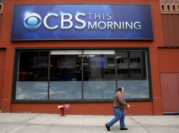A man walks past the CBS News studios at the CBS Broadcast Center on West 57th St. in Manhattan, New York, U.S., April 29, 2016. REUTERS/Brendan McDermid