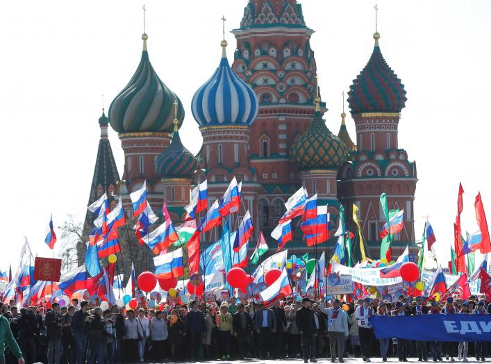 People walk with flags at Red Square during a May Day rally in Moscow, Russia, May 1, 2016. REUTERS/Maxim Zmeyev