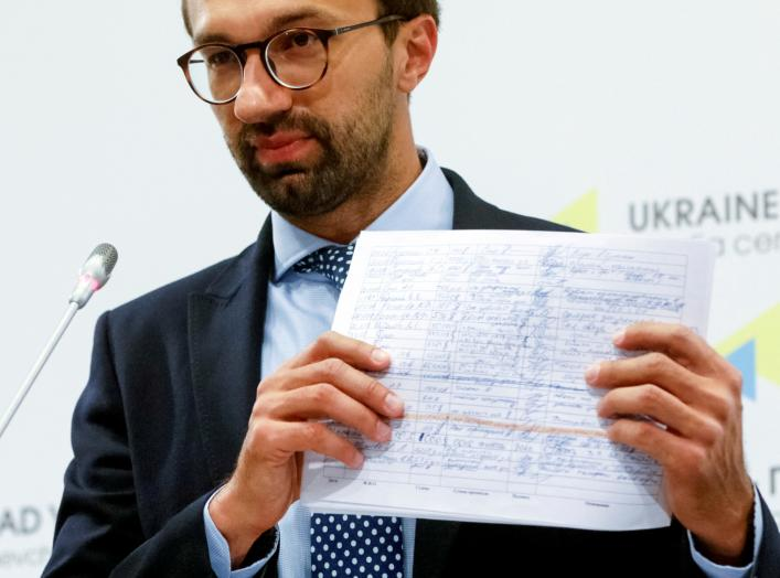 Ukrainian lawmaker Serhiy Leshchenko displays papers from secret ledgers belonging to Party of Regions of former Ukraine's President Viktor Yanukovich during a news conference in Kiev, Ukraine, August 19, 2016. REUTERS/Valentyn Ogirenko