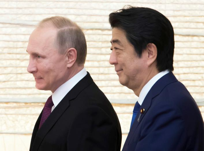 Vladimir Putin, Russia's president, and Shinzo Abe, Japan's prime minister, arrive for a working lunch at the prime minister's official residence in Tokyo, Japan, on Friday, Dec. 16, 2016. REUTERS/Tomohiro Ohsumi/Pool