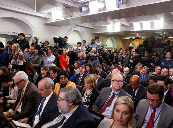 Journalists wait for U.S. President Barack Obama to start his annual year-end news conference at the White House in Washington, U.S., December 16, 2016. REUTERS/Jonathan Ernst