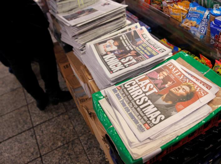 A newstand sells newspapers featuring the image of late singer George Michael in Manhattan, New York City, U.S., December 26, 2016. REUTERS/Andrew Kelly
