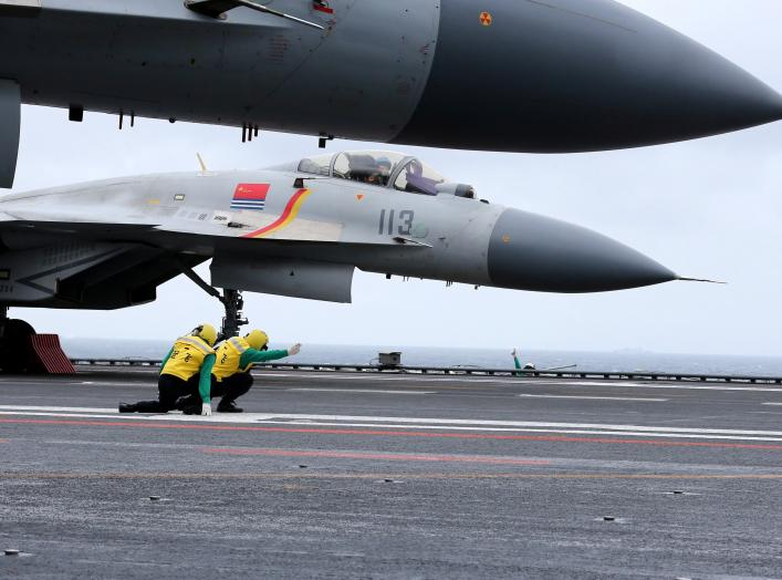 J-15 fighters from China's Liaoning aircraft carrier conduct a drill in an area of South China Sea, January 2, 2017.