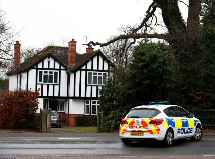 A police car drives past an address which has been linked by local media to former British intelligence officer Christopher Steele, who has been named as the author of an intelligence dossier on President-elect Donald Trump, in Wokingham, Britain, January