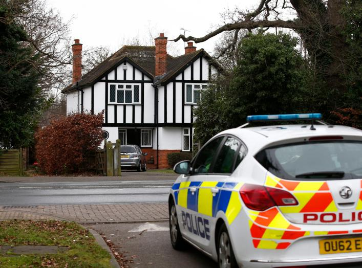 A police car drives past an address which has been linked by local media to former British intelligence officer Christopher Steele, who has been named as the author of an intelligence dossier on President-elect Donald Trump, in Wokingham, Britain