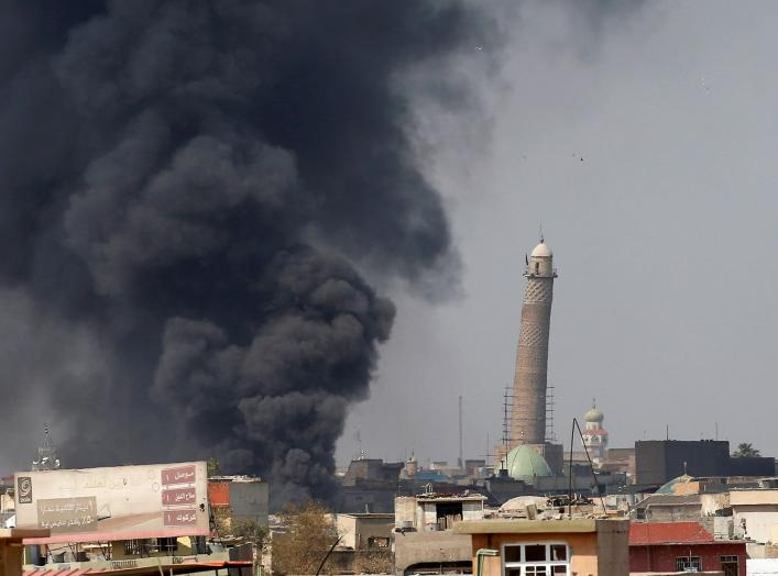 Smoke rises from clashes near Mosul's Al-Habda minaret at the Grand Mosque, where Islamic State leader Abu Bakr al-Baghdadi declared his caliphate back in 2014, as Iraqi forces battle to drive out Islamic state militants from the western part of Mosul, Ir