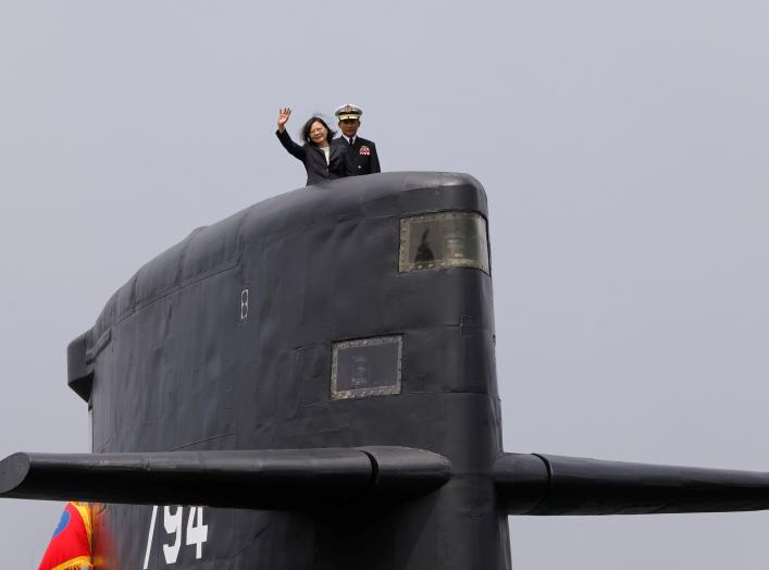 Taiwan President Tsai Ing-wen waves as she boards Hai Lung-class submarine (SS-794) during her visit to a navy base in Kaohsiung, Taiwan March 21, 2017. REUTERS/Tyrone Siu TPX IMAGES OF THE DAY