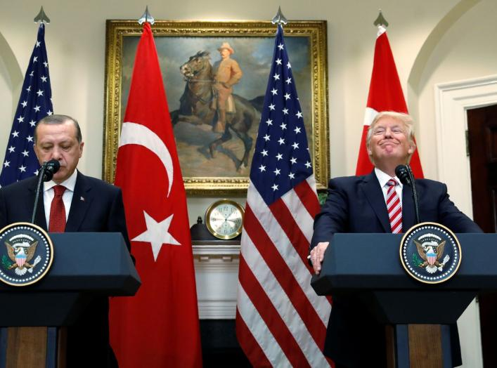 Turkey's President Recep Tayyip Erdogan (L) and U.S President Donald Trump deliver statements to reporters in the Roosevelt Room of the White House in Washington, U.S. May 16, 2017. REUTERS/Kevin Lamarque TPX IMAGES OF THE DAY