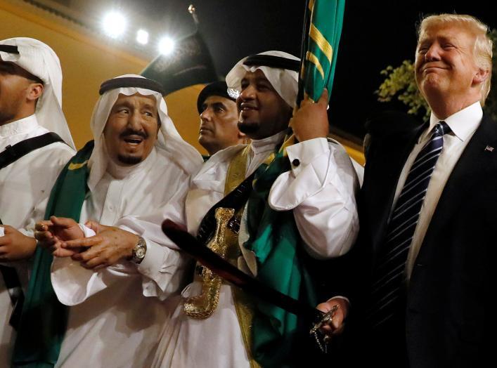 Saudi Arabia's King Salman bin Abdulaziz Al Saud (2nd L) welcomes U.S. President Donald Trump to dance with a sword during a welcome ceremony at Al Murabba Palace in Riyadh, Saudi Arabia May 20, 2017. REUTERS/Jonathan Ernst