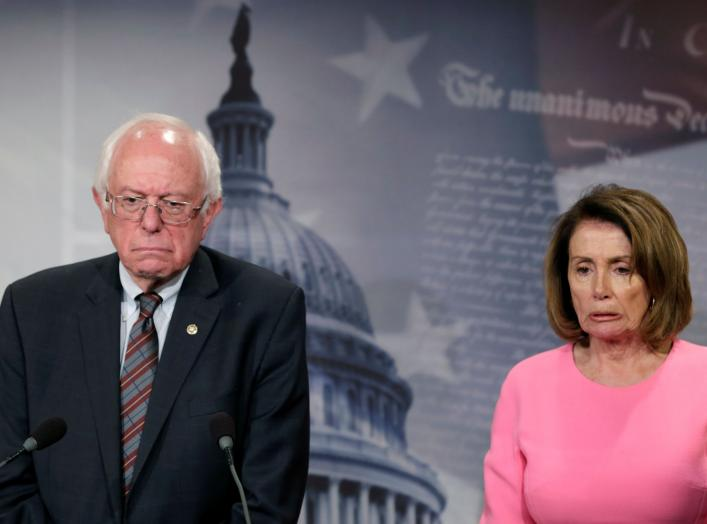U.S. House Minority Leader Nancy Pelosi (D-CA) and Sen. Bernie Sanders (I-VT) react during a news conference on release of the president's FY2018 budget proposal on Capitol Hill in Washington, U.S., May 23, 2017. REUTERS/Yuri Gripas TPX IMAGES OF THE DAY