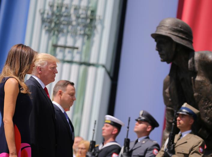 First Lady of the U.S. Melania Trump, U.S. President Donald Trump and Polish President Andrzej Duda stand in front of the Warsaw Uprising Monument at Krasinski Square, in Warsaw, Poland July 6, 2017. REUTERS/Carlos Barria