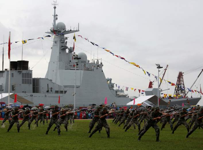 People's Liberation Army Navy soldiers perform in front of destroyer Yinchuan at a naval base in Hong Kong, China July 8, 2017. REUTERS/Bobby Yip