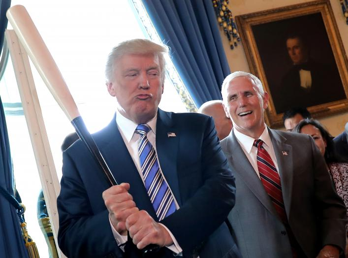 Vice President Mike Pence laughs as U.S. President Donald Trump holds a baseball bat as they attend a Made in America product showcase event at the White House in Washington, U.S., July 17, 2017. REUTERS/Carlos Barria TPX IMAGES OF THE DAY