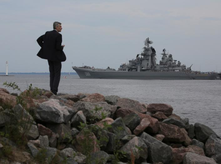 A man looks at the Russian nuclear missile cruiser Pyotr Veliky (Peter the Great) on the eve of the Navy Day parade in Kronshtadt, a seaport town in the suburb of St. Petersburg, Russia, July 28, 2017.