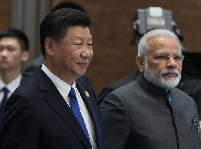 Chinese President Xi Jinping (L) and Indian Prime Minister Narendra Modi, arrive for the 'Dialogue of Emerging Market and Developing Countries' on the sidelines of the 2017 BRICS Summit in Xiamen, Fujian province, China, 05 September 2017. REUTERS/Wu Hong