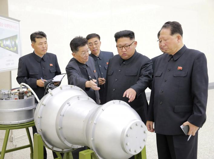 North Korean leader Kim Jong Un provides guidance with Ri Hong Sop (2nd L) and Hong Sung Mu (R) on a nuclear weapons program in this undated photo released by North Korea's Korean Central News Agency (KCNA) in Pyongyang September 3, 2017. KCNA via REUTER