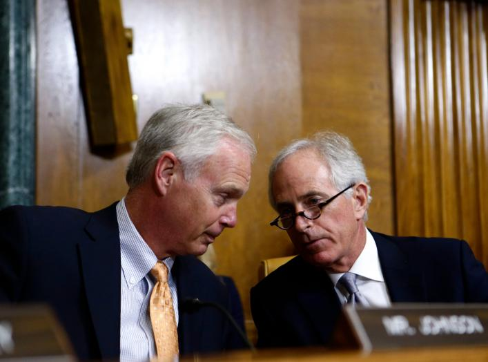 Senators Ron Johnson (R-WI) and Bob Corker (R-TN) speak during the U.S. Senate Budget Committee markup of the FY2018 Budget reconciliation legislation on Capitol Hill in Washington, U.S., November 28, 2017. REUTERS/Joshua Roberts