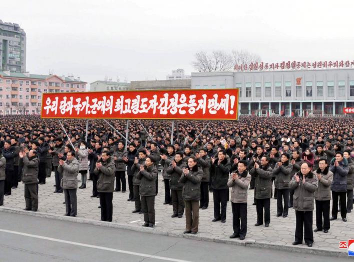 People rally to hail the completion of the state nuclear force, the cause of building a rocket power under the guidance of the Workers' Party of Korea, in this in this undated photo released by North Korea's Korean Central News Agency (KCNA) on December 6
