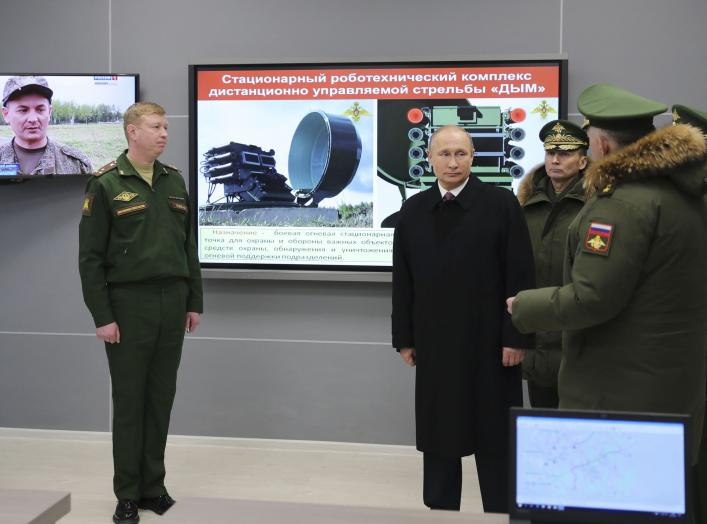 Russian President Vladimir Putin (2nd L) visits the Military Academy of the Strategic Missile Forces, named after Peter the Great, outside Moscow, Russia December 22, 2017. Sputnik/Mikhail Klimentyev/Sputnik via REUTERS ATTENTION EDITORS - THIS IMAGE WAS