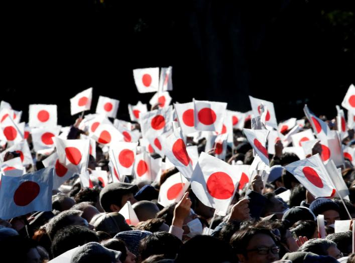 Well-wishers wave Japanese national flags as Japan's Emperor Akihito (not pictured) appears on a balcony of the Imperial Palace during a public appearance for New Year celebrations at the Imperial Palace in Tokyo, Japan, January 2, 2018. REUTERS/Toru Hana