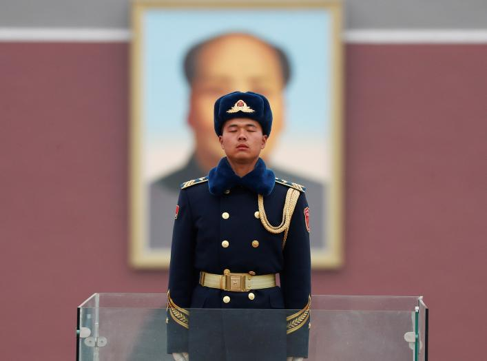 A member of Chinese People's Liberation Army (PLA) stands guard in front of a portrait of late Chinese Chairman Mao Zedong at the Tiananmen in Beijing, China March 4, 2018.
