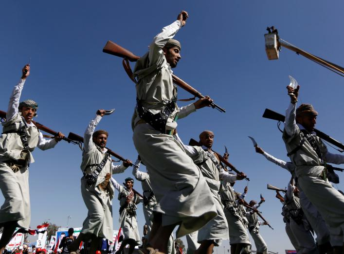 Houthi performers dance during a rally to mark the third anniversary of the Saudi-led intervention in the Yemeni conflict in Sanaa, Yemen March 26, 2018. REUTERS/Khaled Abdullah