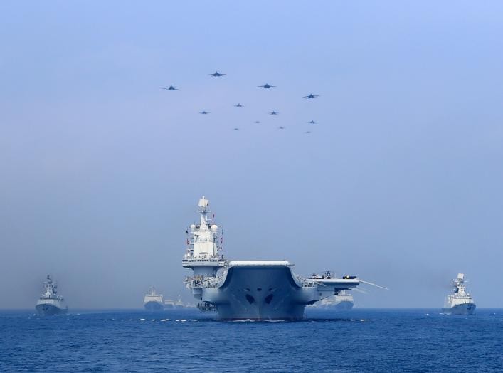Warships and fighter jets of Chinese People's Liberation Army (PLA) Navy take part in a military display in the South China Sea April 12, 2018. Picture taken April 12, 2018. REUTERS/Stringer