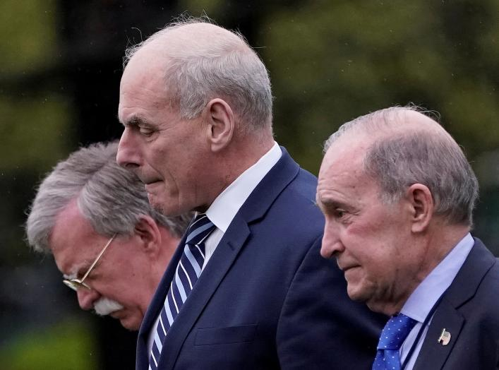 White House Chief of Staff John Kelly, White House chief economic adviser Larry Kudlow (R) and new National Security Advisor John Bolton (L) leave the Oval Office as U.S. President Donald Trump departs the White House for a trip to Miami, Florida, in Wash
