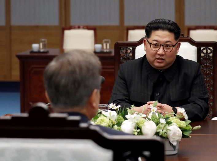North Korean leader Kim Jong Un talks to South Korean President Moon Jae-in during their meeting at the Peace House at the truce village of Panmunjom inside the demilitarized zone separating the two Koreas, South Korea, April 27, 2018.