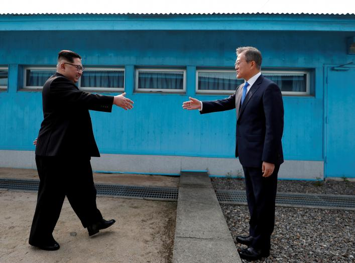 South Korean President Moon Jae-in and North Korean leader Kim Jong Un shake hands at the truce village of Panmunjom inside the demilitarized zone separating the two Koreas, South Korea, April 27, 2018. Korea Summit Press Pool/Pool via Reuters