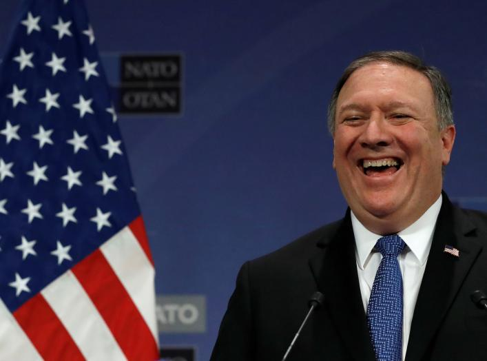 U.S. Secretary of State Mike Pompeo smiles as he attends a news conference after a NATO foreign ministers meeting at the Alliance's headquarters, in Brussels, Belgium April 27, 2018. REUTERS/Yves Herman