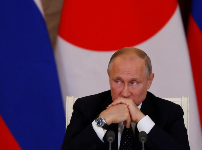 Russian President Vladimir Putin attends a joint news conference with Japanese Prime Minister Shinzo Abe following their meeting at the Kremlin in Moscow, Russia May 26, 2018