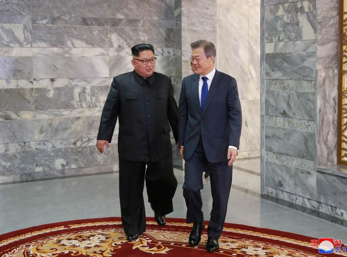 South Korean President Moon Jae-in meets with North Korean leader Kim Jong Un during their summit at the truce village of Panmunjom, North Korea, in this handout picture released by North Korea's Korean Central News Agency (KCNA) on May 27, 2018. KCNA/via